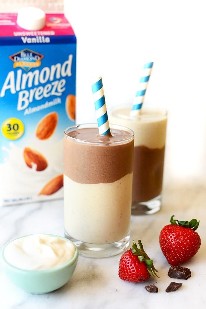 layered chocolate banana smoothie with almond breeze carton in the background