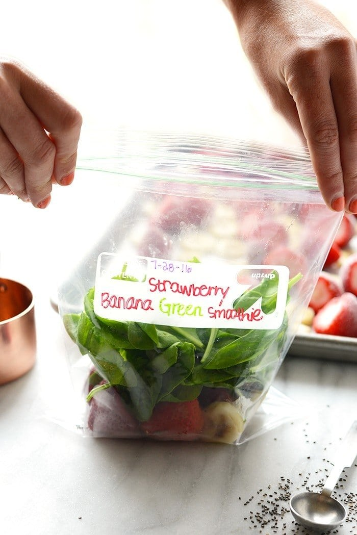 Make a smoothie in under 60 seconds with my smoothie meal prep in a bag secret! You'll have this Strawberry Banana Green Smoothie made in no time!