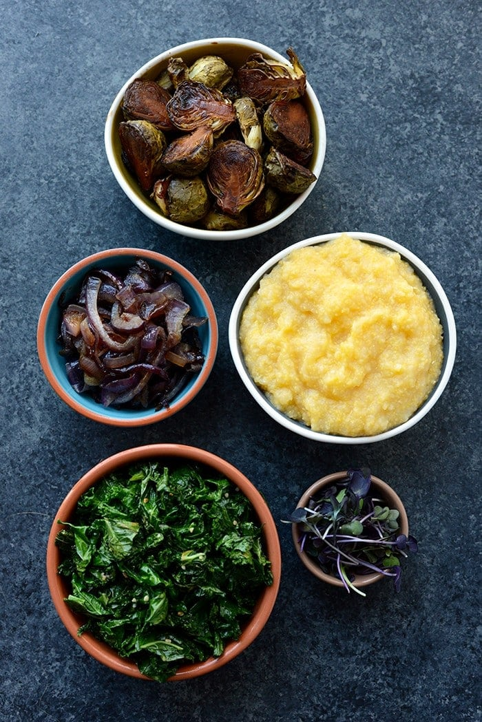 Vegetarian Meal Prep Idea: Meal prep like a vegetarian boss and make these Roasted Brussels Sprout Polenta Bowls fully equipped with caramelized onions and kale!