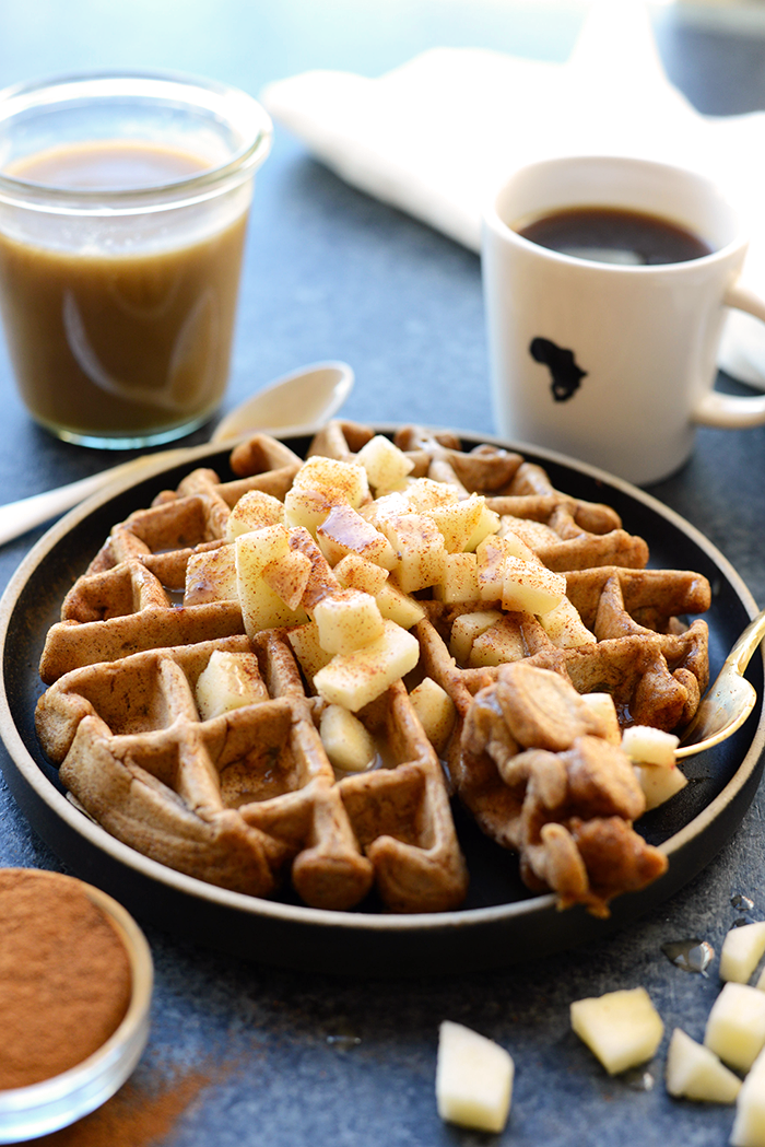 Tis the season of apples and cinnamon! You're going to love these HEALTHY caramel apple cinnamon waffles made with 100% whole wheat flour, apple chunks, tons of cinnamon, and a homemade caramel sauce made from full-fat coconut oil!