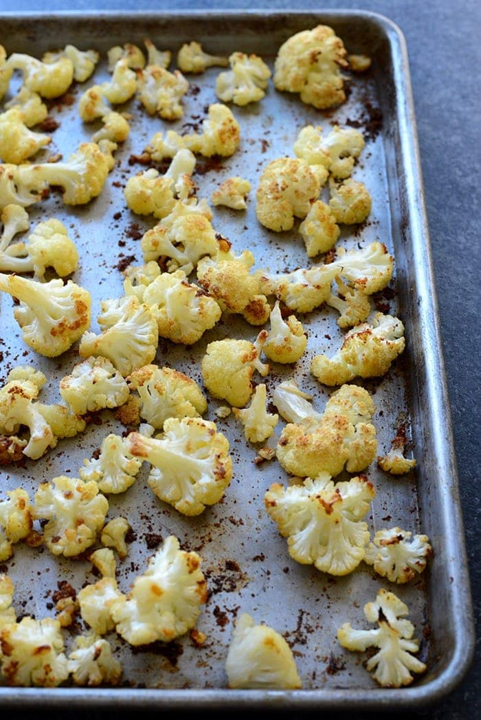 This Super Simple Garlic Roasted Cauliflower is the perfect flavor-packed, healthy side dish for any meal. It even makes for a great snack!