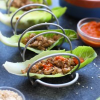 chicken lettuce wraps with korean style chicken in taco holder