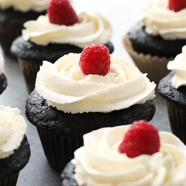 healthier chocolate cupcakes topped with a fresh raspberry