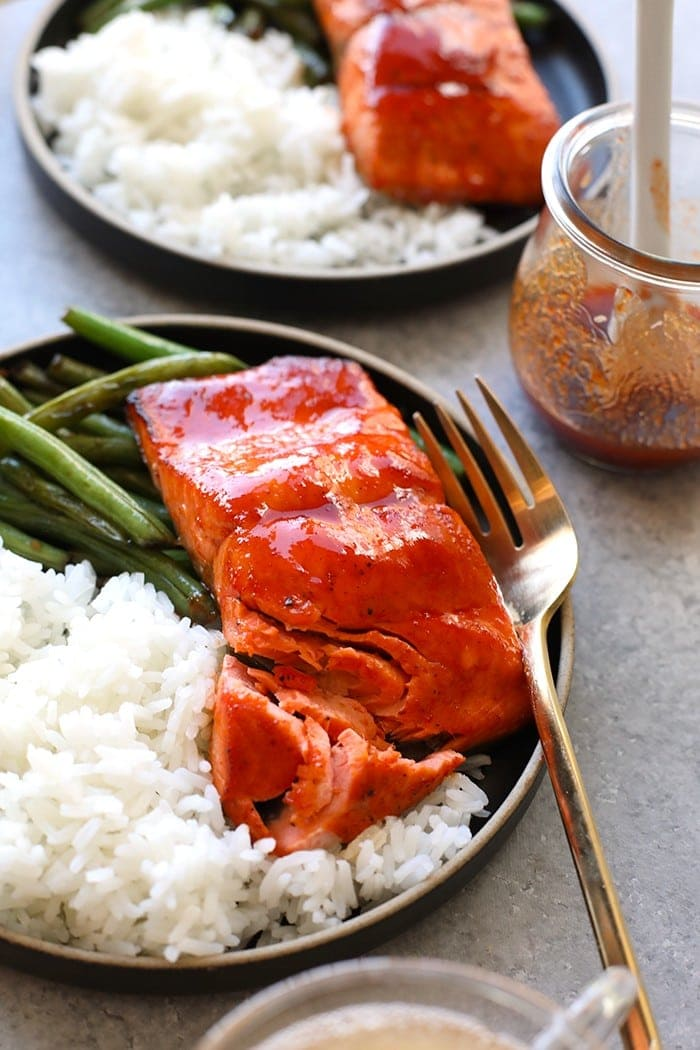 honey sriracha salmon on plate with white rice and green beans