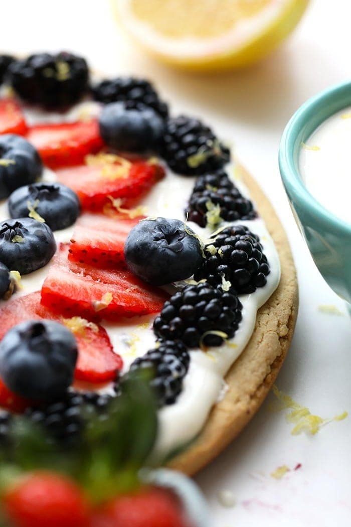 Delicious healthy fruit pizza with berries and lemon zest