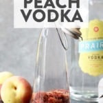 peach infused vodka in a glass jar