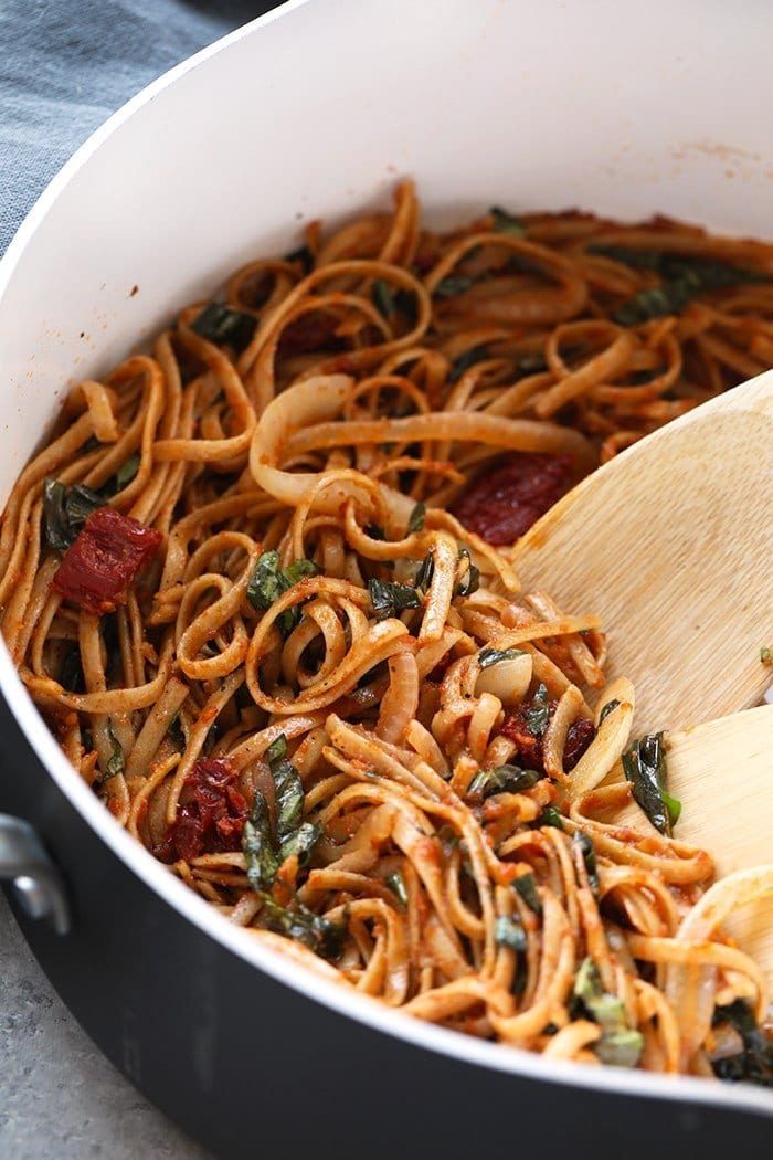 sun dried tomato pasta with whole wheat noodles in pan