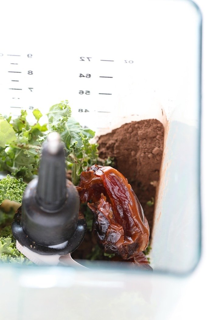 dates, kale and chocolate in blender
