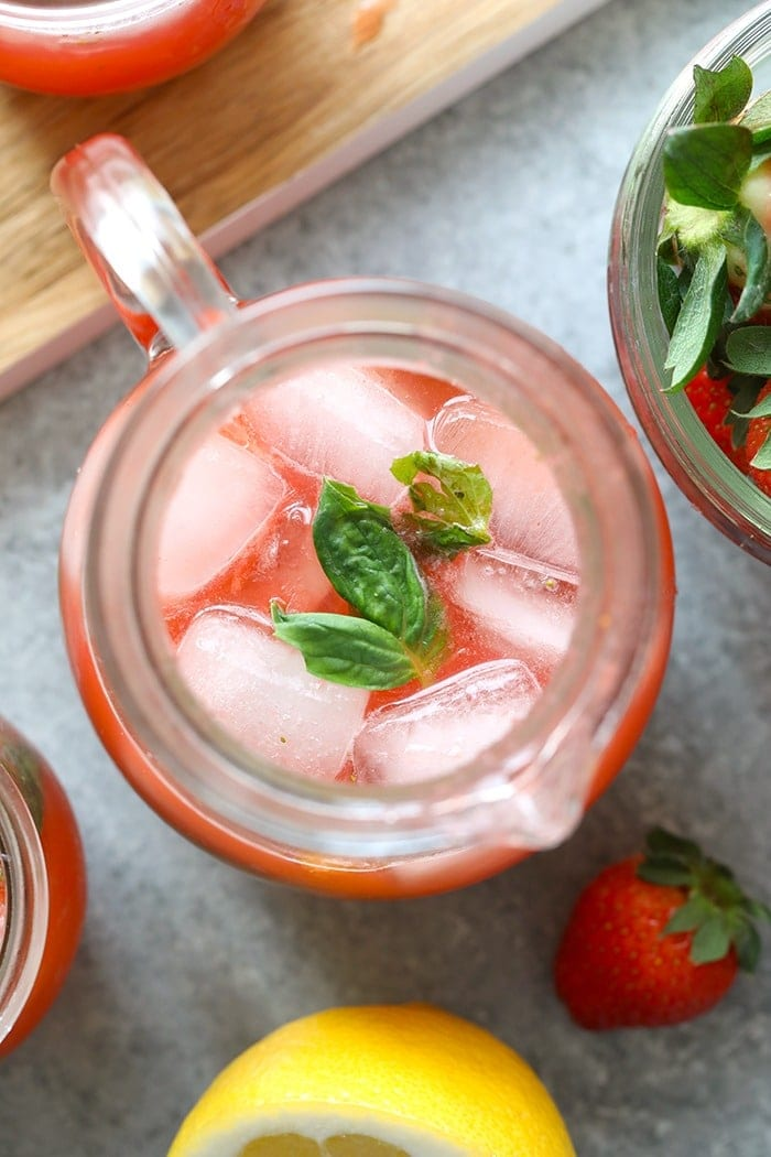 strawberry basil lemonade in a pitcher