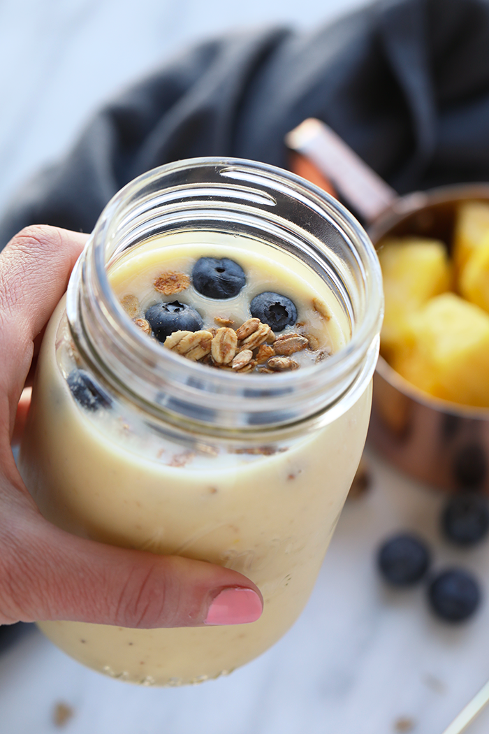 Smoothies are the perfect on-the-go healthy breakfast or delicious snack. Add this Refreshing Ginger Pineapple Smoothie to your rotation this summer, it won't disappoint!