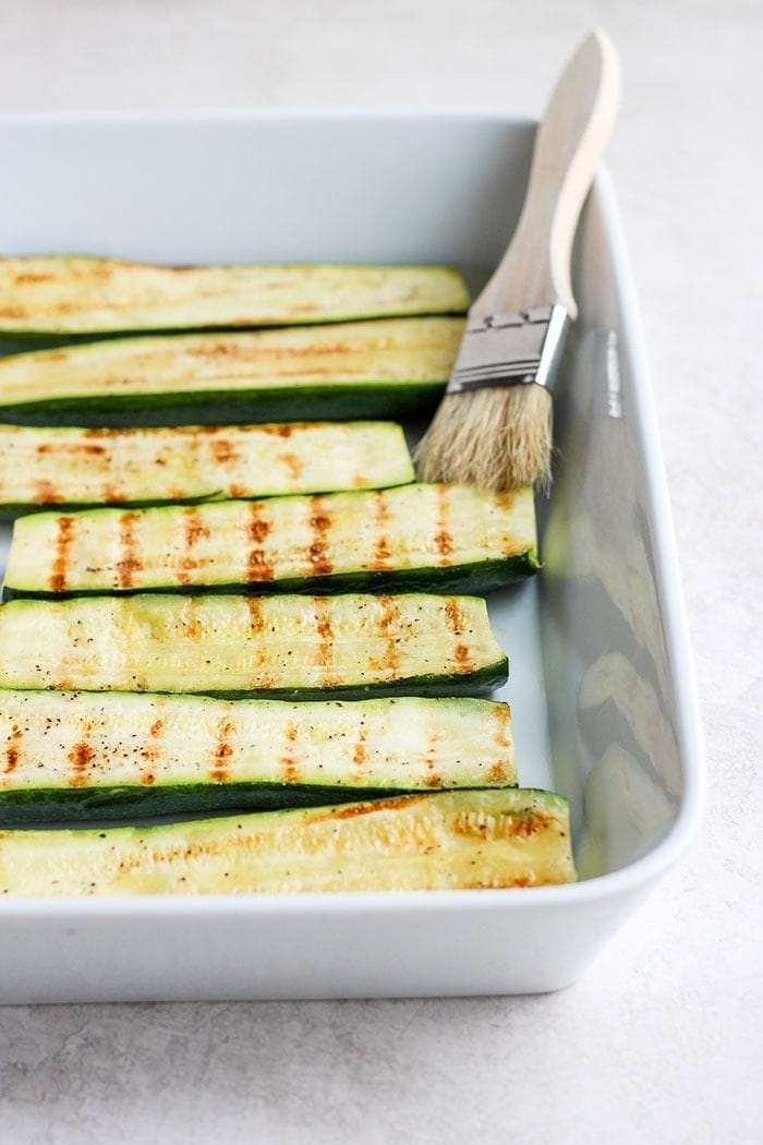 grilled zucchini in a baking dish