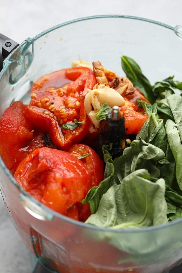 tomatoes, garlic, and basil in food processor