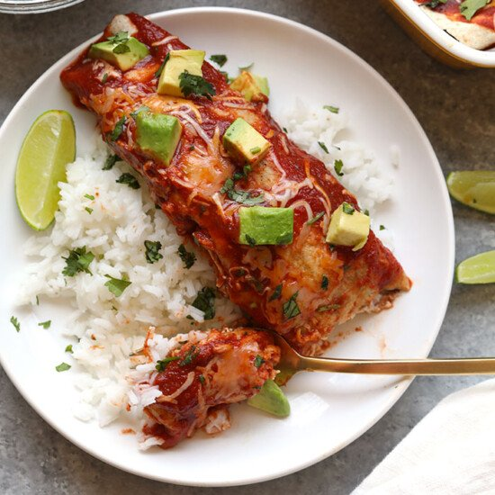 healthy enchilada served over rice topped with avocado