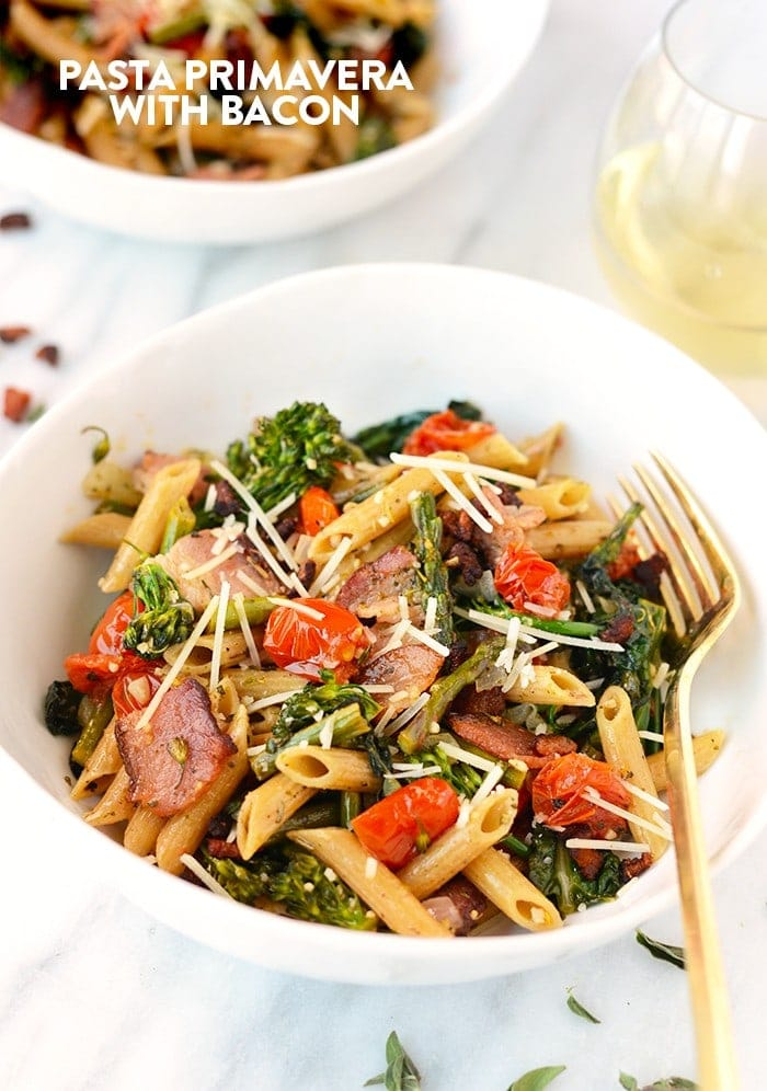 Need to amp up your veggie intake? Make this Whole Wheat Pasta Primavera with Bacon for a full serving of veggies and whole grains for the most perfect spring pasta dish EVER.