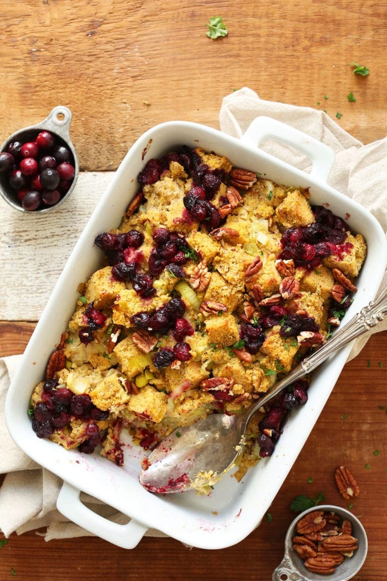 Savory, flavorful, tender cornbread stuffing with roasted cranberries, sautéed leeks and onions, and pecans. A healthier plant-based side for any occasion.