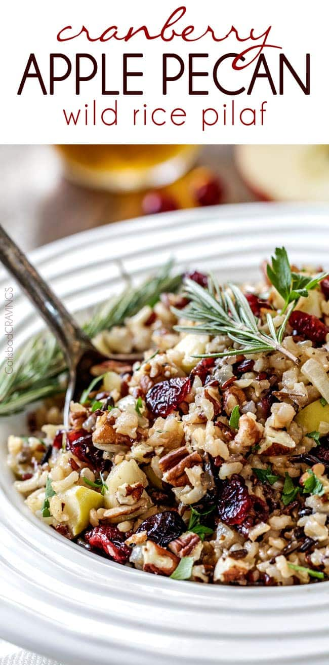 Easy one pot Cranberry Apple Pecan Wild Rice Pilaf simmered in herb seasoned chicken broth and apple juice and riddled with sweet dried cranberries, apples and roasted pecans for an unbelievable savory sweet side dish perfect for the holidays and easy enough for everyday!