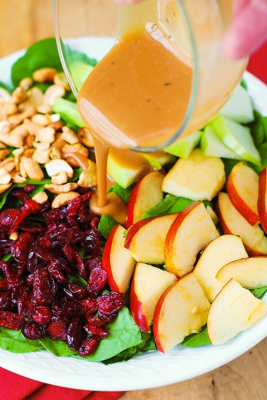 Apple Cranberry Spinach Salad with Balsamic Vinaigrette – healthy, delicious, easy-to-make salad! Perfect for the Thanksgiving menu, this is one looking holiday salad. With lots of good for you ingredients, this recipe is packed with fiber, and it's gluten free!