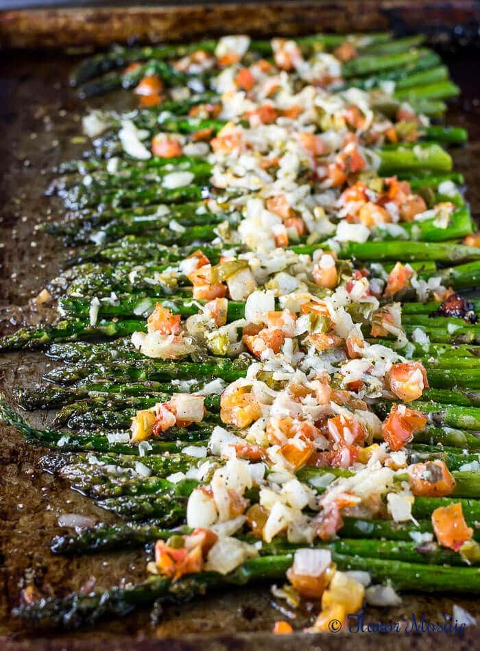 Asiago Bruschetta Roasted Asparagus, with tomatoes, garlic, onions, and asiago cheese, makes a healthy gourmet side dish that can be on the table in 15 minutes and is perfect for brunch, or a weeknight or holiday dinner.