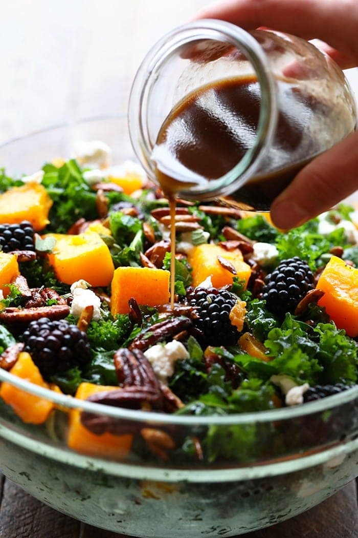 This Harvest Blackberry and Butternut Squash Massaged Kale Salad is an excellent lunch or dinner and even doubles as a holiday salad to share. It's made with roasted butternut squash, candied nuts, Driscoll's blackberries, and massaged kale with a homemade dressing!