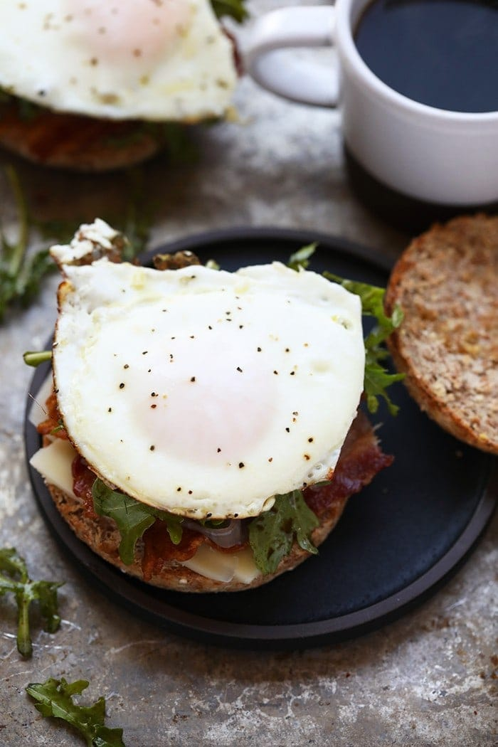 Start the morning off right with this Arugula Breakfast Sandwich with Caramelized Onions! This breakfast sandwich is a simple breakfast made with a whole grain English muffin, peppery arugula, and delicious caramelized onions that leave you with a full belly until lunch!