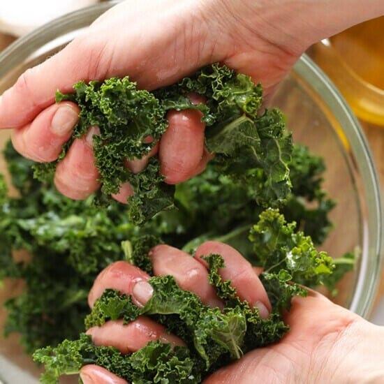 massaging kale in hands