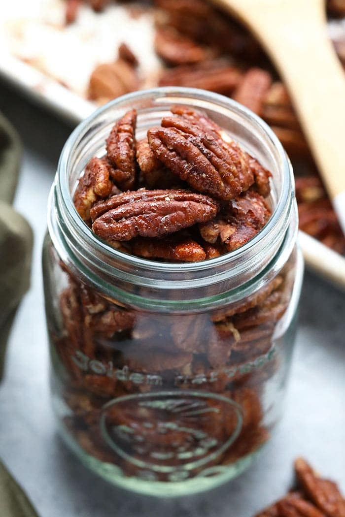Toasted pecans in a glass.