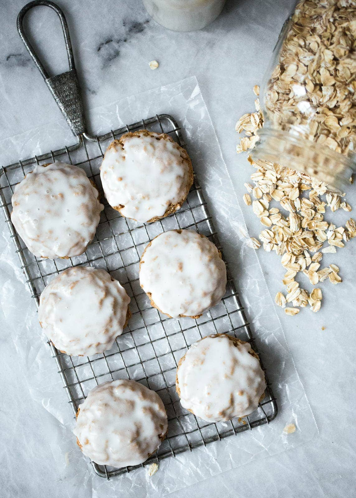 Beautiful chewy cinnamon brown butter oatmeal cookies have a delicious caramel like flavor and are slightly crispy on the edges and chewy in the middle. Finished off with a light icing.