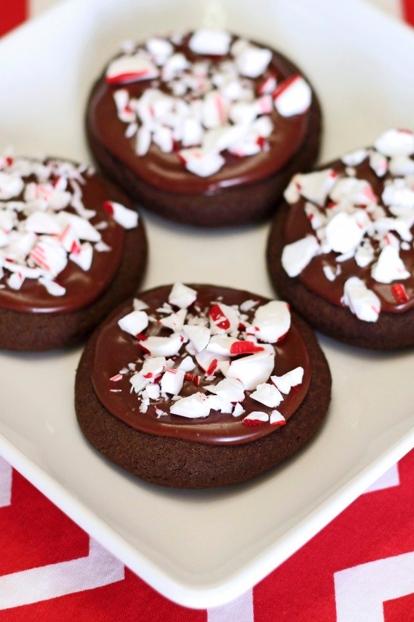 Soft gluten free chocolate cookies. Creamy chocolate peppermint frosting. Crunchy peppermint topping. A new tasty recipe for your next holiday party or cookie swap!