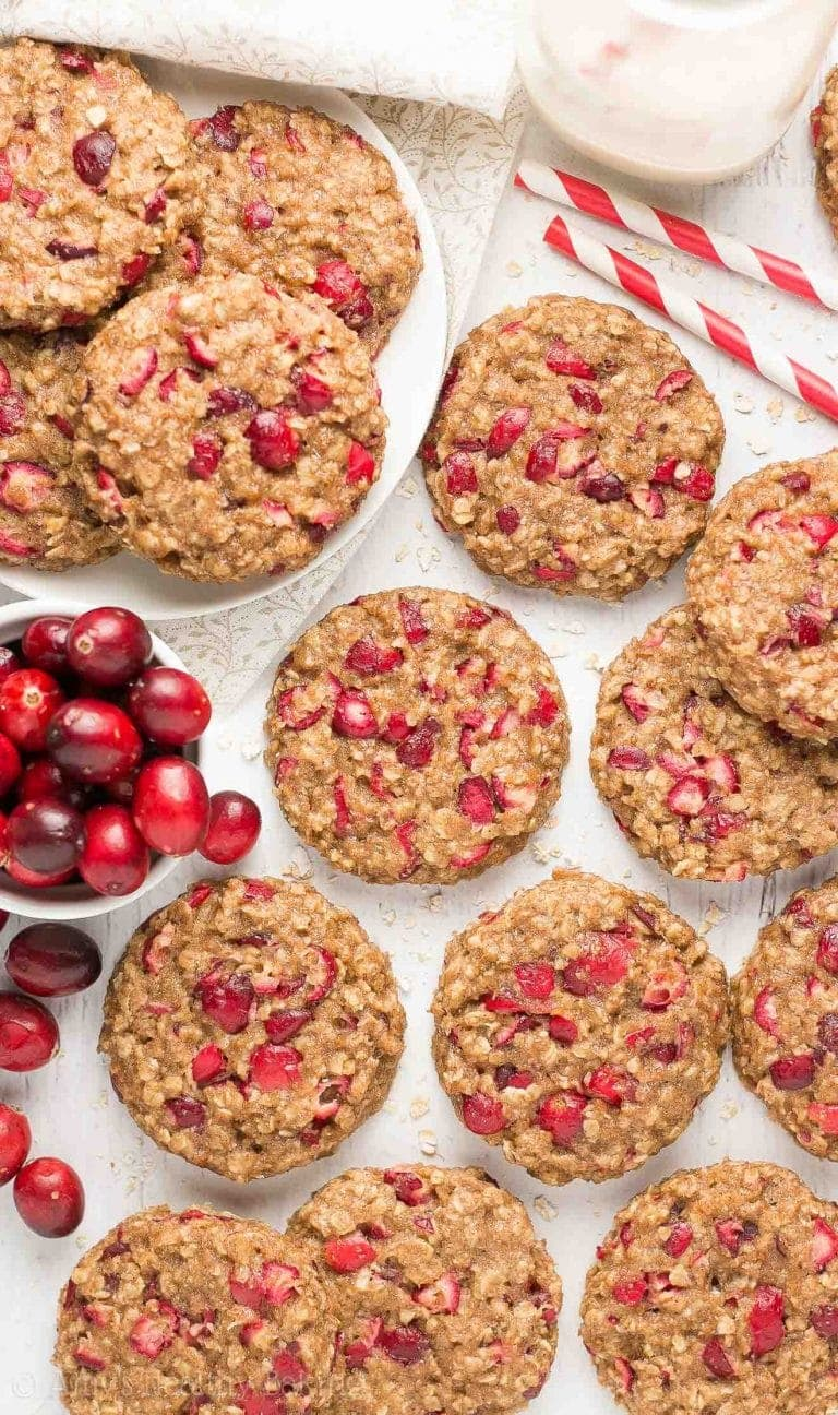An easy, no-mixer-required recipe for chewy banana oatmeal cookies full of tangy cranberries! Only 84 calories with no eggs, refined flour or sugar!