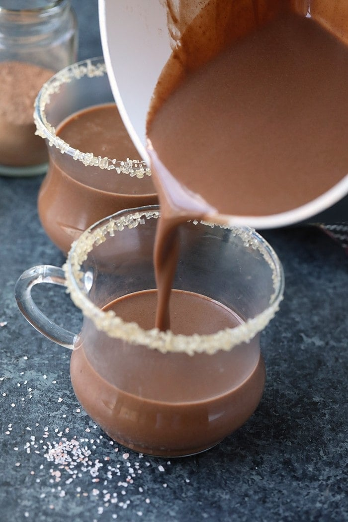 This decadent spiced coconut hot chocolate is made with full-fat coconut milk, a mixture of warm spices, and maple syrup. It's both vegan and paleo-friendly, perfect for the health-minded people out there!