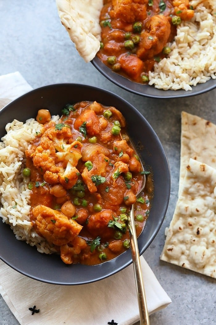 Tikka masala in a bowl with naan on the side