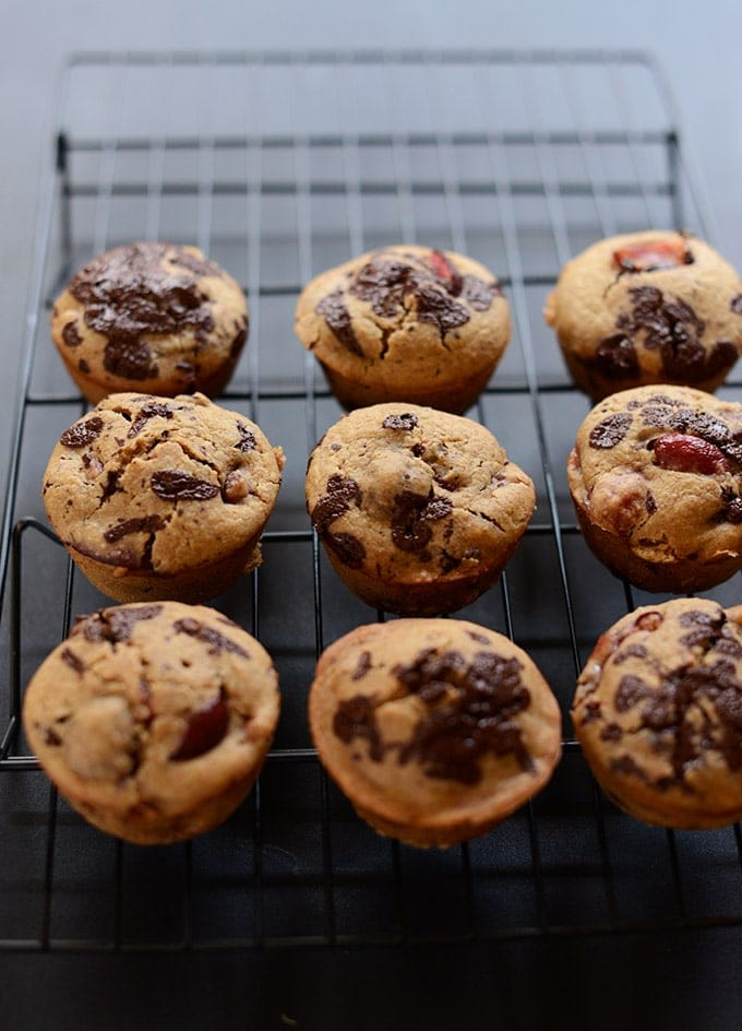 Cherry dark chocolate chip muffins on a cooling rack