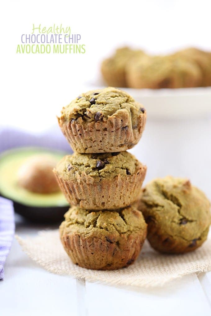 Healthy chocolate chip avocado muffins stacked three high.