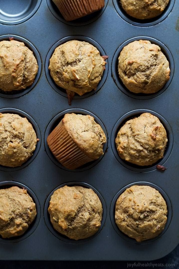 Skinny banana nut muffins displayed in a muffin tin.