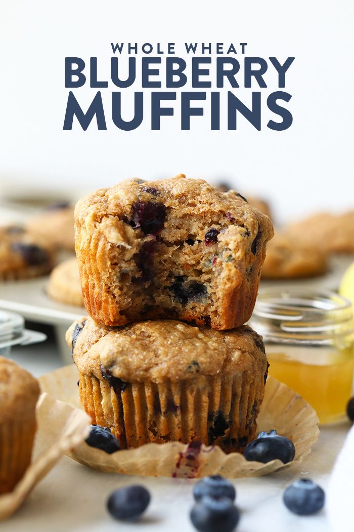 Whole wheat blueberry muffin with a bite taken out of it.