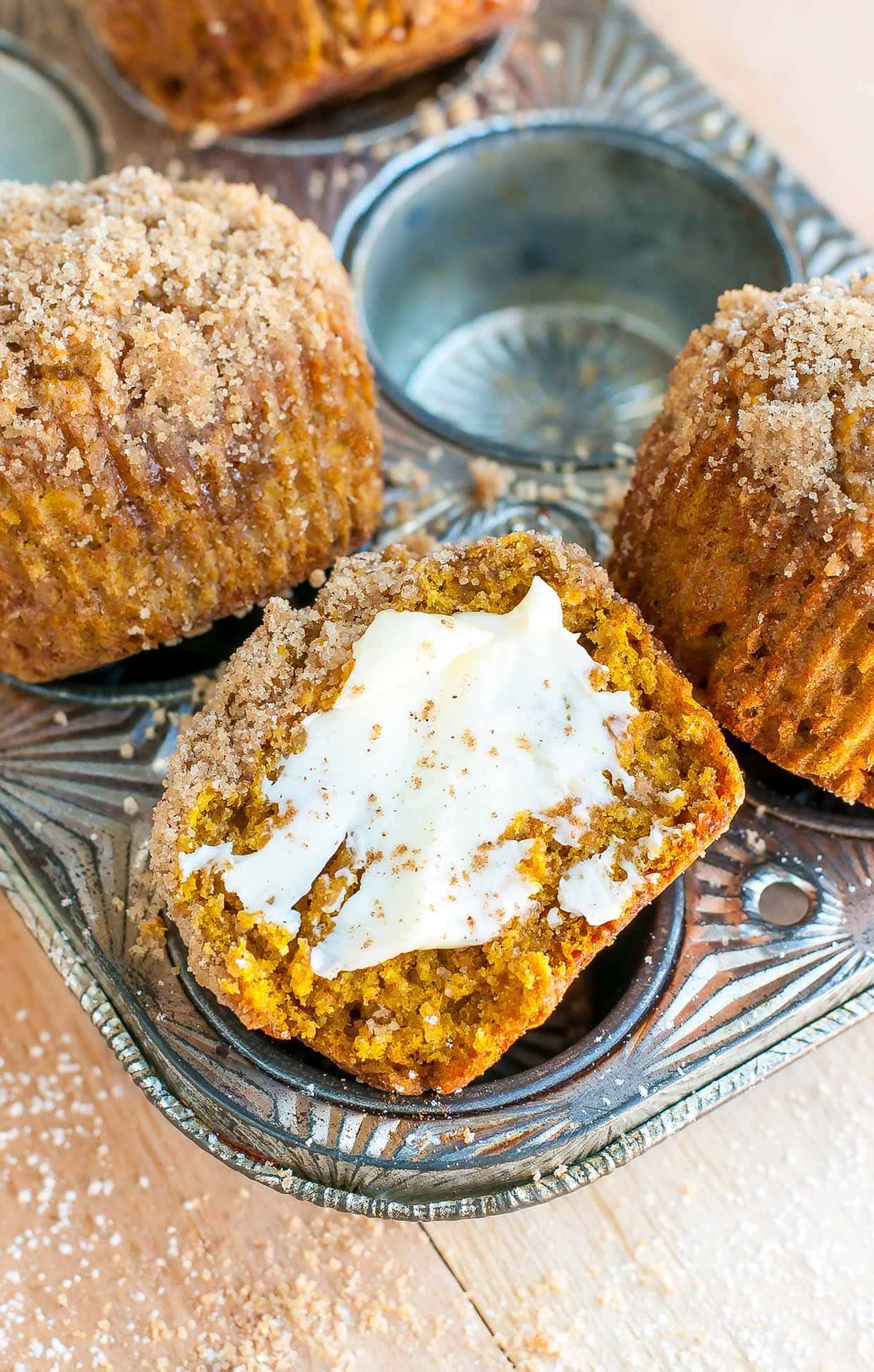 Cinnamon sugar pumpkin spice streusel muffins with butter spread.