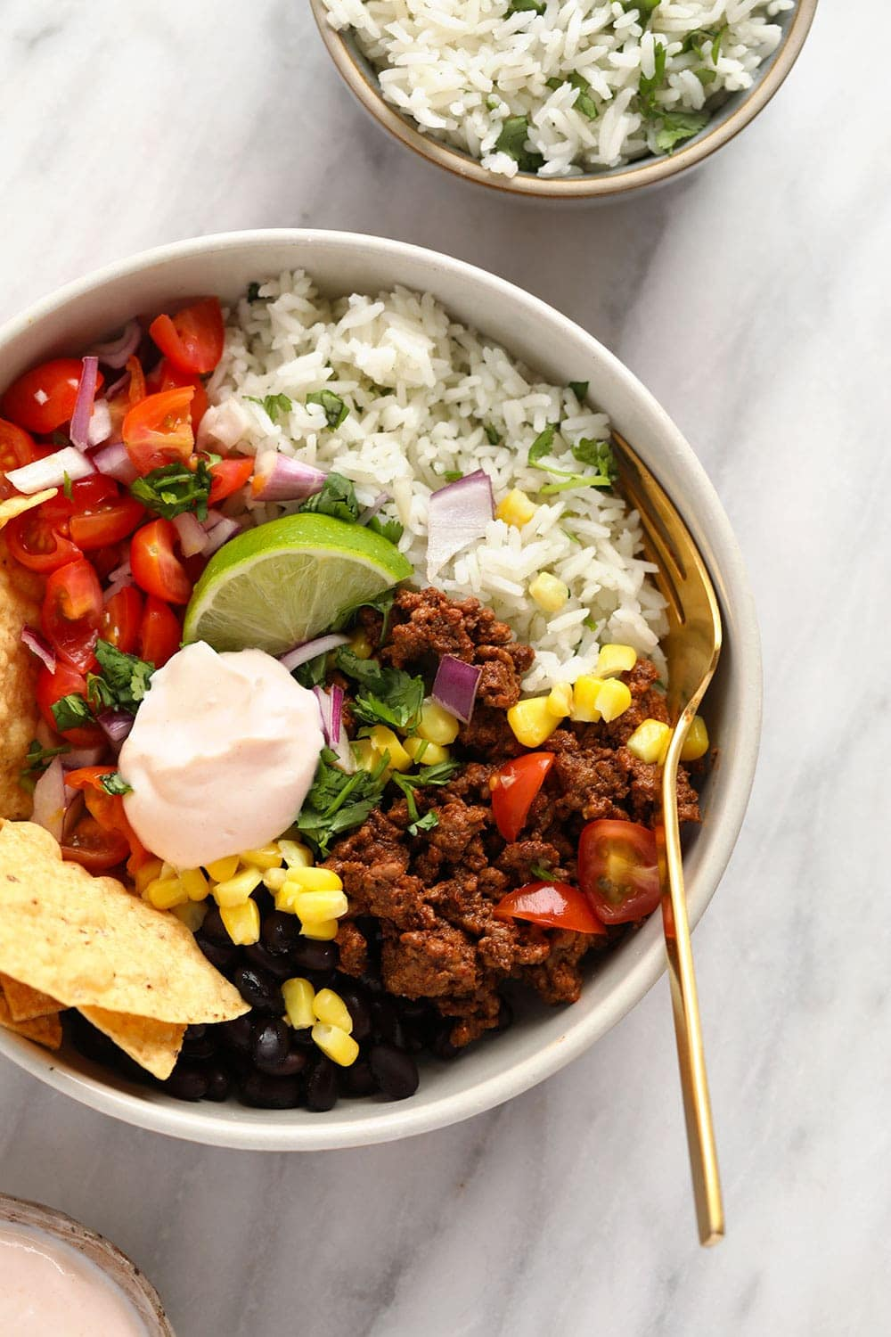 taco bowl with ground beef and cilantro lime brown rice