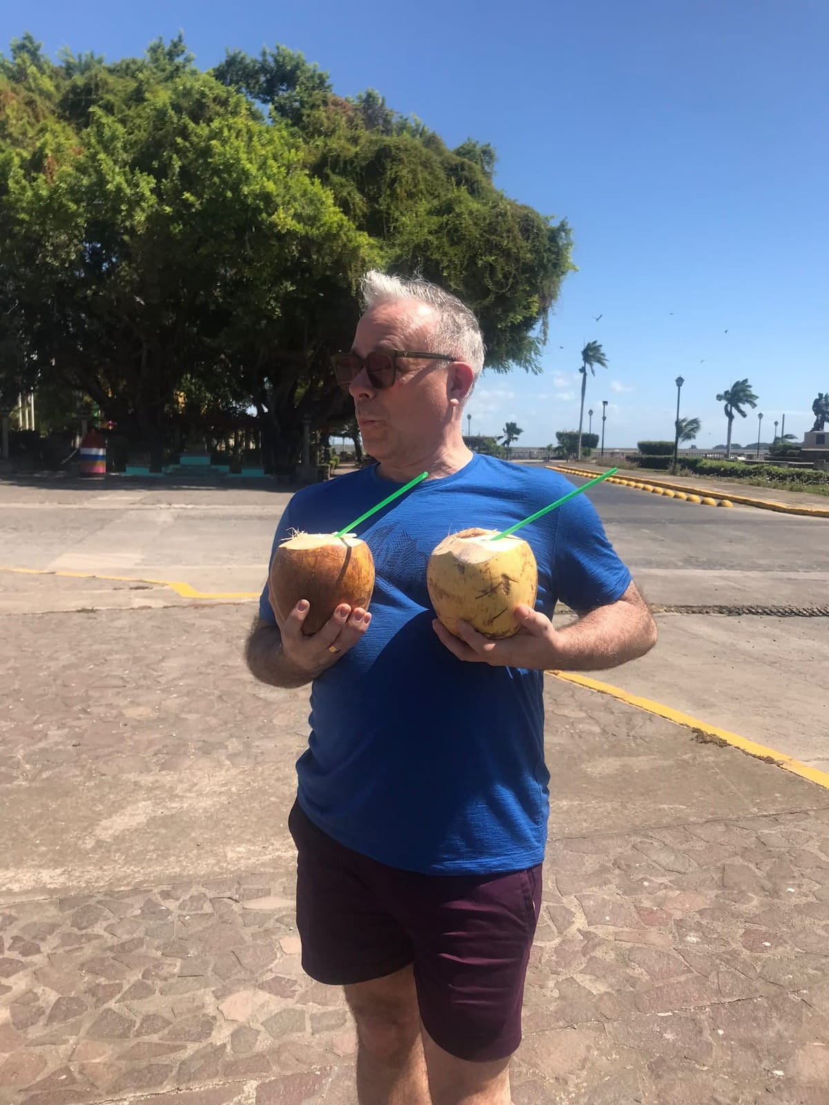 Man with coconuts.