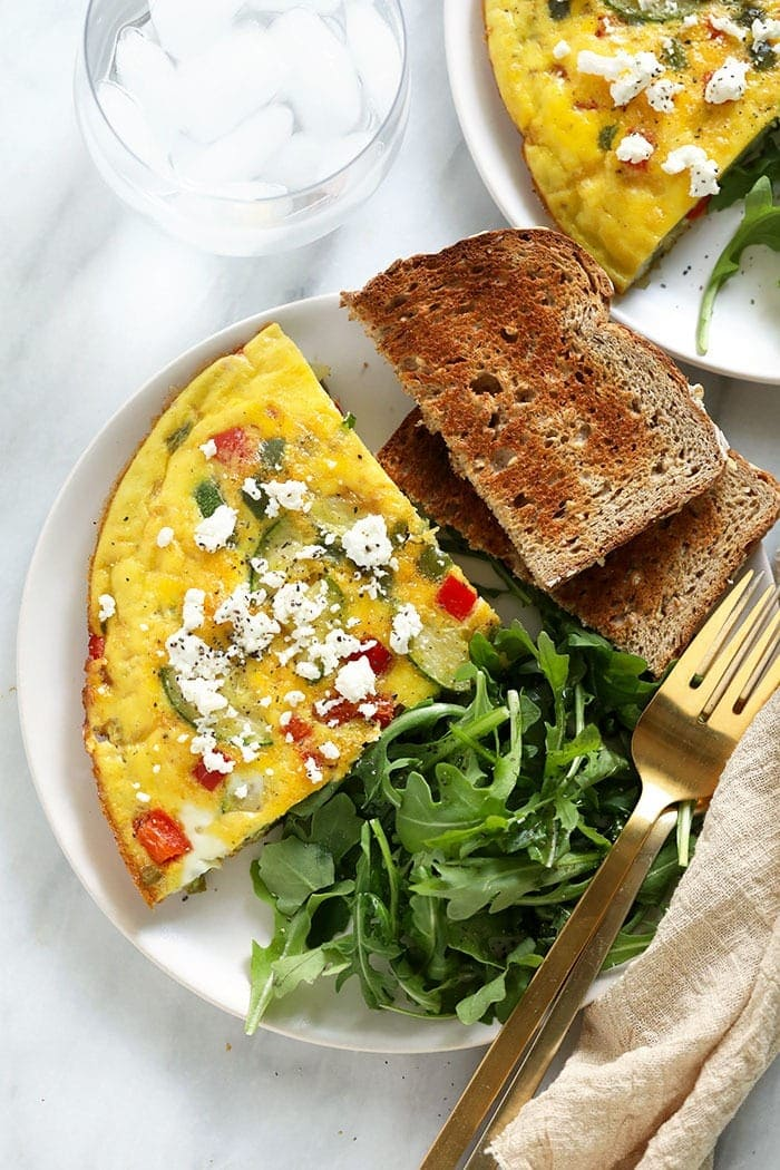 plated frittata, toast, and arugula