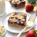 triple berry crumble bar on a plate