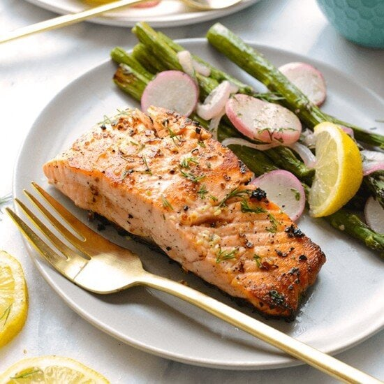 lemon butter pan seared salmon on plate with asparagus