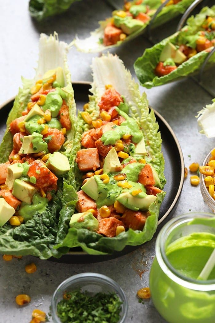 Completed healthy buffalo chicken lettuce wraps served on a plate.