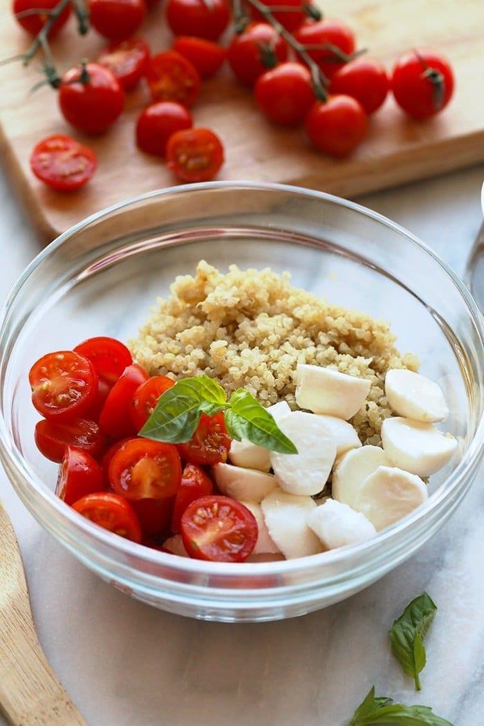 fresh caprese quinoa salad ingredients in a bowl