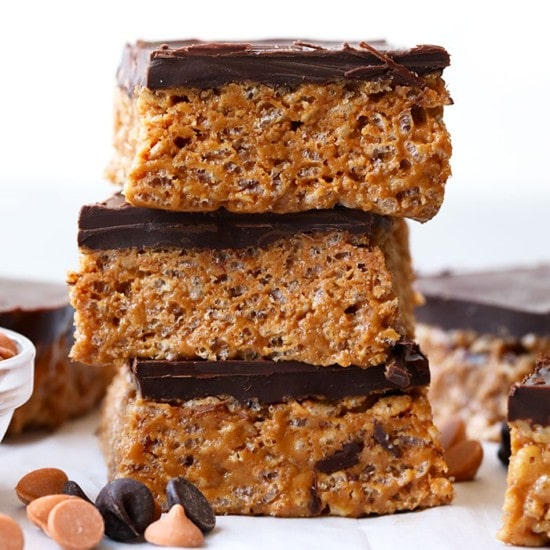 These healthy scotcheroos are made with all natural sugar, unsalted peanut butter, and coconut oil. This scotcheroos recipe has no white sugar or corn syrup! They are ready in no time and a great healthy spin on a classic church lady basement bar.