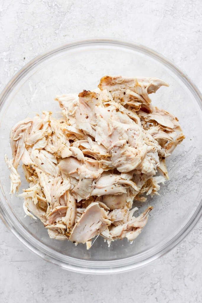 Plain shredded chicken in a bowl.
