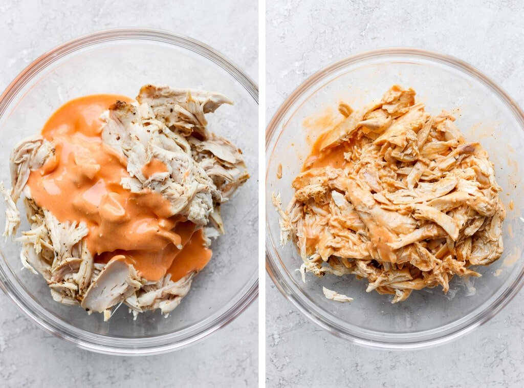 Shredded buffalo chicken being tossed with buffalo sauce.
