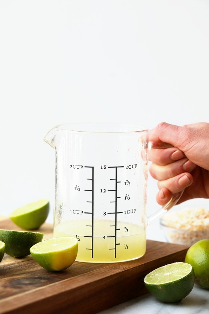 Measuring cup full of key lime juice