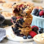 triple berry oatmeal cups stacked on a plate