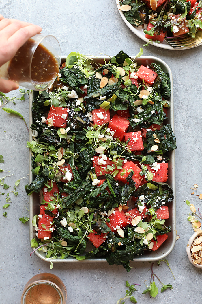 Finished kale and watermelon salad on a baking sheet