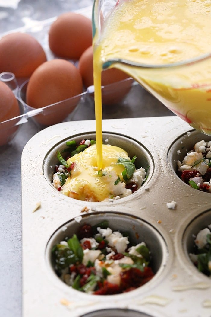 Pouring eggs into a muffin tin